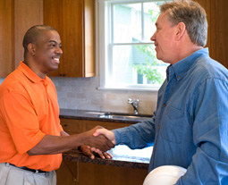 A flooring contractor in Chicago, IL shaking hands with a customer.